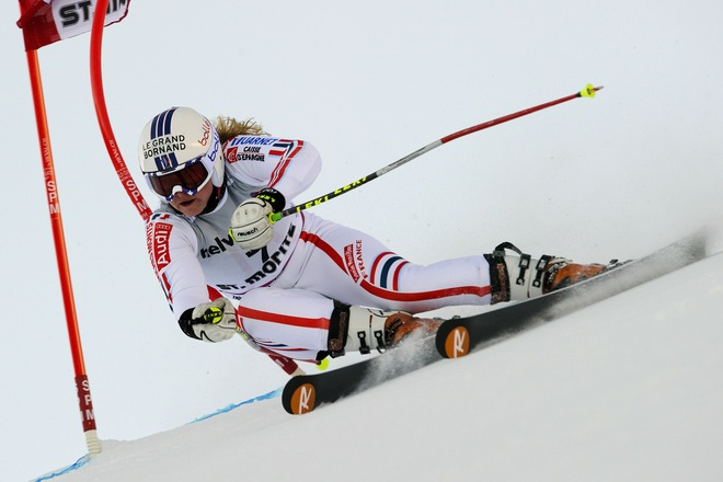 France's Tessa Worley clears a gate during the first run of the alpine skiing World Cup giant slalom race on December 12, 2010 in Saint Moritz.  AFP PHOTO / FABRICE COFFRINI (Photo credit should read FABRICE COFFRINI/AFP/Getty Images)